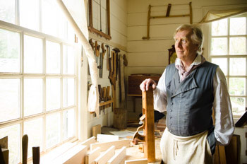 Kaare Loftheim Inside The Hays Cabinet Shop At Colonial Williamsburg Holding A Hand Plane At His Workbench